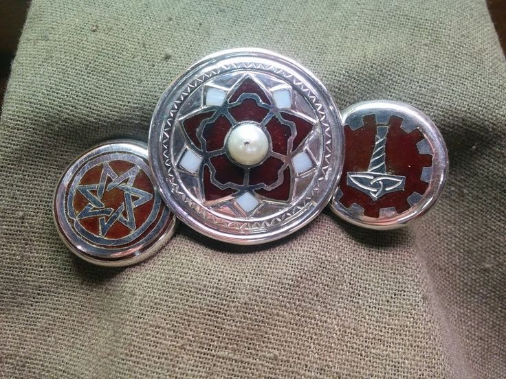 Enameled brooches