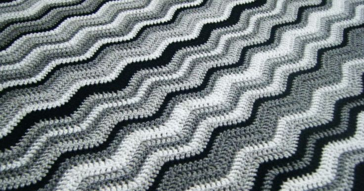Zebra crochet ripple blanket with lacy edging