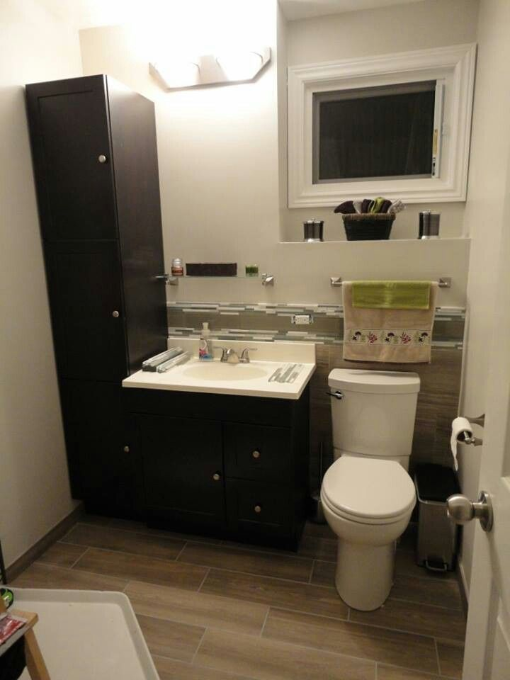 Toilet, Vanity and linen cabinet are in. Backsplash completed.
