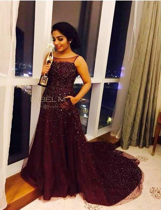 Rejisha Vijayan In Wine Red Sleeveless Gown Detailed With
