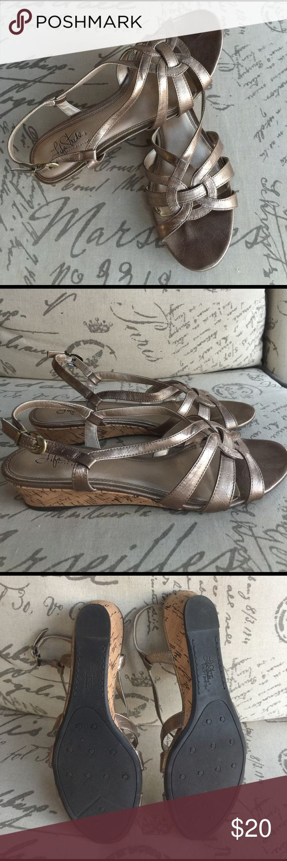Life Stride Soft System Pewter Sandals Ready for summer! These almost new comfy sandals will be your grab and go pair every day. We all need more shoes that literally go with everything. These are a 9.5 sandal. I loved them so much so I bought them. But I'm a true 10. Just am not grabbing for them as much as I hoped do to the smaller size. Now you can enjoy my mistake and have a great go to pair of sandals this summer. No flaws. Can't even tell these been worn a few times. Life Stride Shoes…