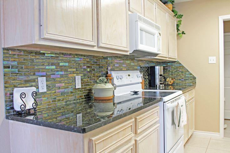 Coastal Kitchen Design With Iridescent Green Backsplash