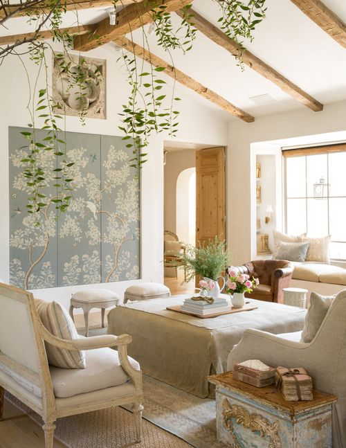 Fabulous shabby chic living room - the chinoiserie panels hide the TV!