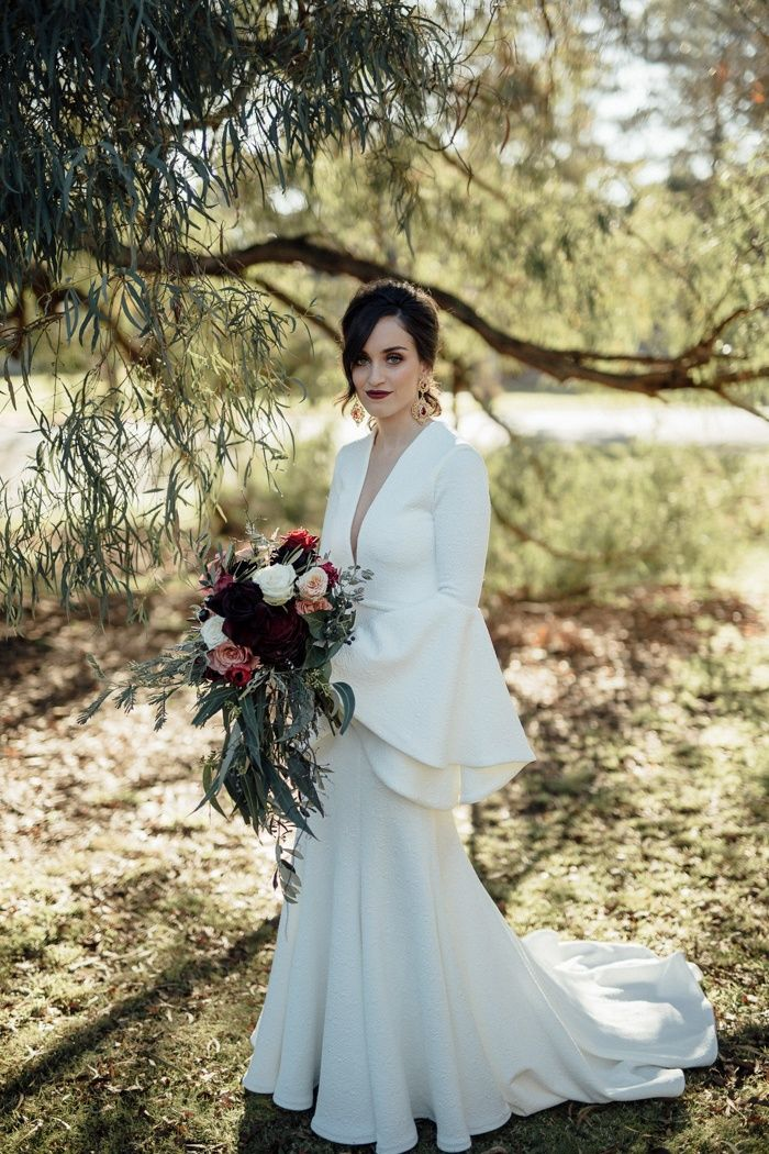 Sultry smokey eye and dark red lip as bridal makeup is perfect for a fall or winter wedding   Image by Free the Bird