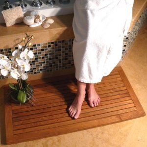 Wooden bath mat: a nice little addition to create a spa atmosphere in a bathroom. @Hansgrohe SE SE USA #BathroomDreams