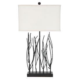 "Wrought iron table lamp with branch-shaped detail and a linen box shade.   Product: Table lampConstruction Material: Wrought iron, resin and linen fabricColor: Dark brownFeatures: 3-Way switchAccommodates: (1) 100 Watt incandescent bulb - not includedDimensions: 30.5"" H x 18"" W x 7"" D"