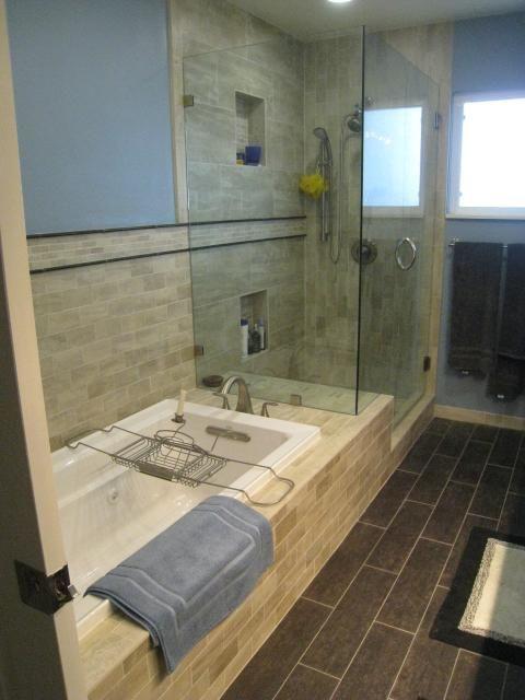 Transitional bathroom with sand tiles and a bathtub/shower installation. #designmine