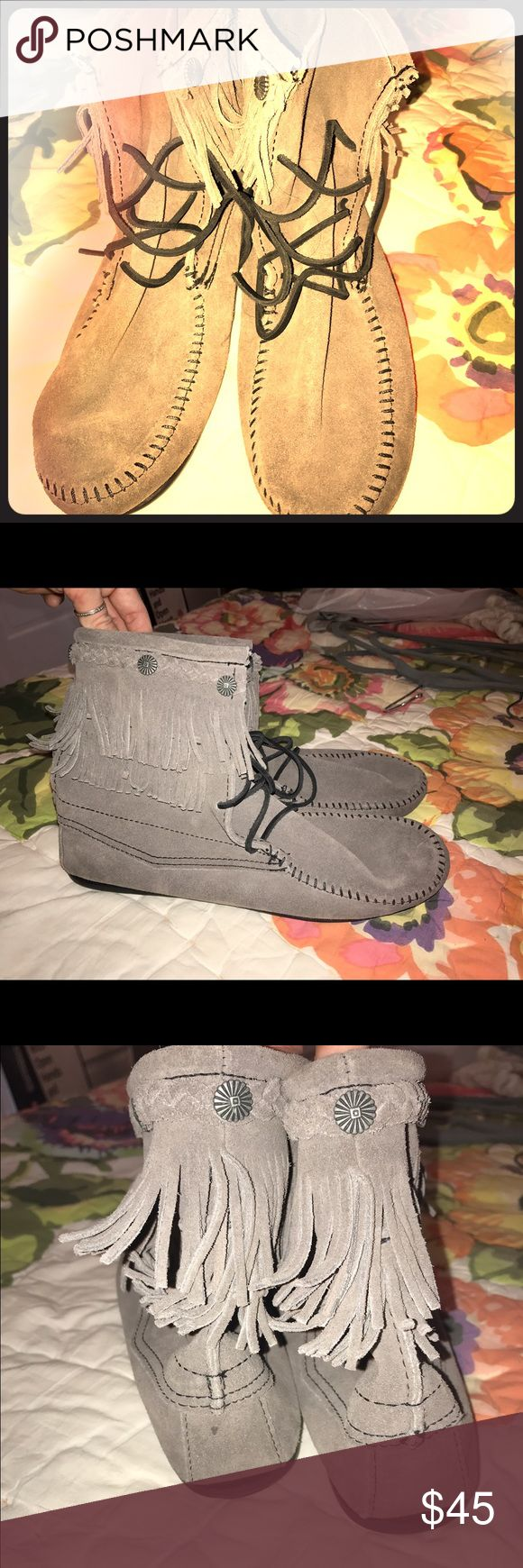 Gray Minnetonka fringe ankle boots Gray Minnetonka fringe ankle boots. Never been worn. US Size 10. Minnetonka Shoes Ankle Boots & Booties