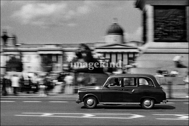 """""""Trafalgar Square and the Black Cab, London"""" by Aldo Cervato, Italy // Trafalgar Square and the Black Cab, London. Medium: Black and White Film. Authentication labels signed by the artist are available free of charge with orders over $100. Please go to www.aldogallery.com to order them (or to www.aldocervato.com) // Imagekind.com -- Buy stunning, museum-quality fine art prints, framed prints, and canvas prints directly from independent working artists and photographers."""