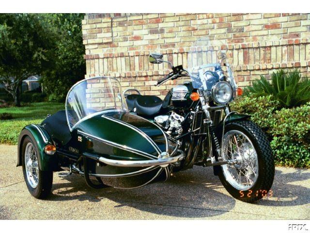 british racing green triumph thunderbird and sidecar (looks like a