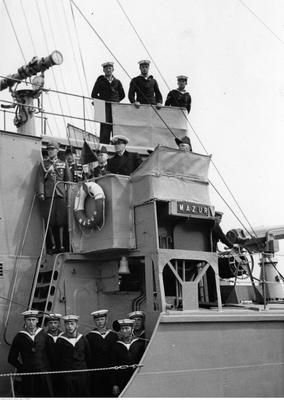 Standing on the bridge deck of ORP Mazur (from left to right) Captain Jan Huber, Captain Stefan Kryński, Rear Admiral Jerzy Świrski and President of Poland Ignacy Mościcki. Photograph taken 11 VII 1937 in port of Gdynia, Poland.