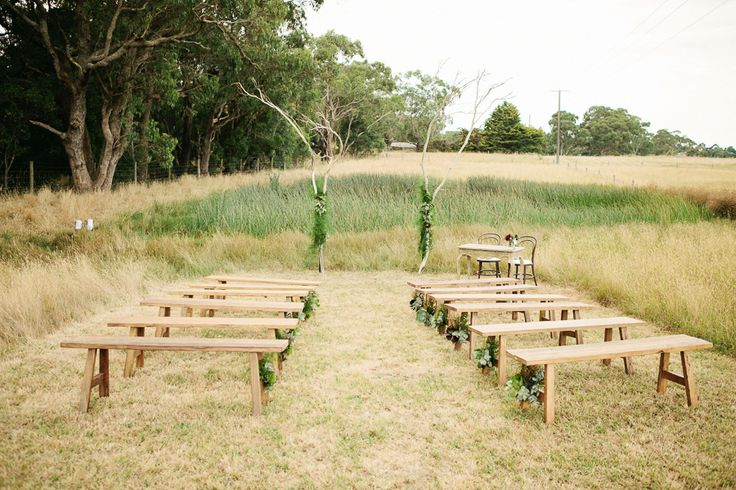 I seriously love the look of benches for a wedding ceremony...wish they weren't so uncomfortable to sit on for any length of time