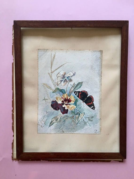 An antique original watercolor with a black and red butterfly and flowers. Signed and dated the right bottom corner E.B. 1904. On the left side an handwritten note reads Le papillon et le fleur!!!... (The butterfly and the flower). All those exclamation points and ellipses make me think of a allusive dedication, maybe to a lover. This painting could be a very romantic, precious present for a loved one. The watercolor is in good antique condition, with some stains that confirm its…