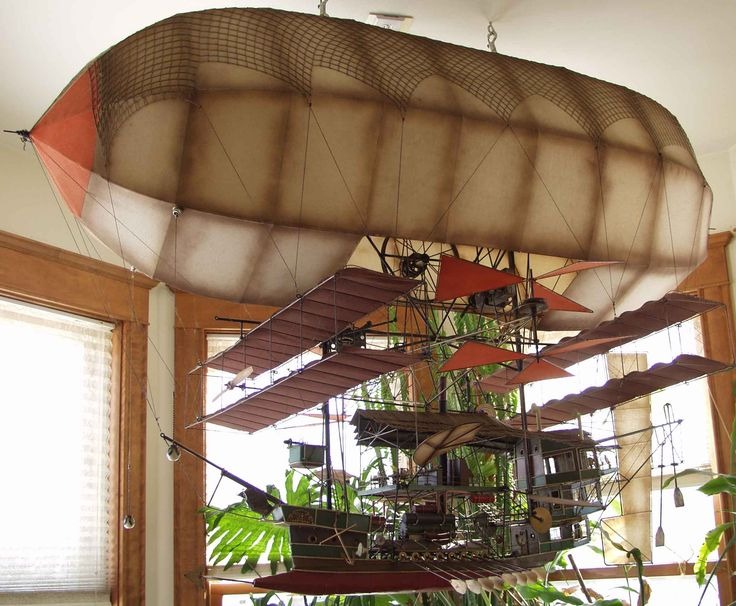 "Steampunk airship by  Edward J. ""Skeeter"" Wachtendonk Sr. Flying Dutchman Co. This is a metal and fabric airship sculpture the lights inside the Zeppelin illuminate and a motor with numerous gears animate, move, paddle, spin and turn just about everything on the ship."