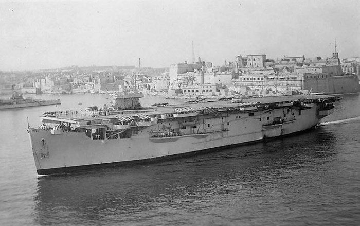 Atheling slides gracefully out of Valetta Harbour , Malta. On certain websites, attributed to voyage from UK to Ceylon via Suez Canal in March of 1944. The problem here is paint scheme lacks dazzle paint camouflage she had in 1944. Fact that she shows no aircraft on decks and extra life rafts tied along flight deck clearly indicates image is post-war when she committed to trooping duties, bringing service personnel and civilians back to UK.
