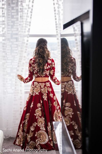 Bride taking a look outside the window. http://www.maharaniweddings.com/gallery/photo/102414