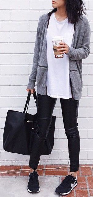@findingpris is wearing a long sleeved grey cardigan with a white t shirt, black leather trousers and Nike sneakers