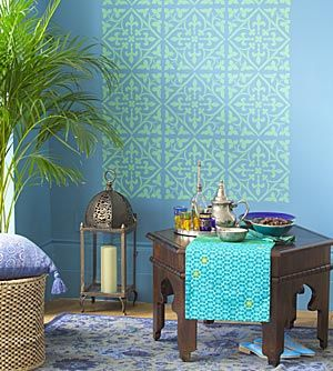 A striking wall design created with a large tile stencil gives this room a Moroccan touch.