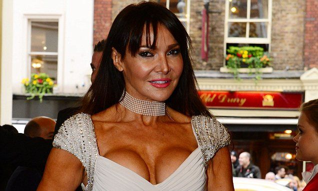 The Duchess of Cambridge's reaction came when she espied the deeply tanned decolletage of WAG Lizzie Cundy (pictured), ex-wife of former Chelsea player Jason Cundy.