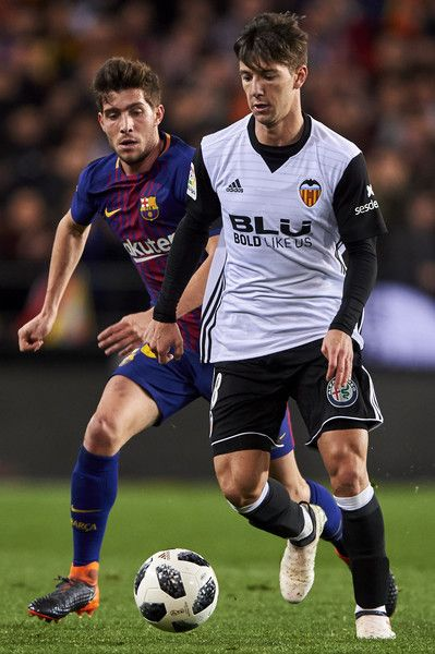 Luciano Vietto of Valencia CF is challenged by Sergi Roberto of FC Barcelona during the Copa de Rey semi-final second leg match between Valencia and Barcelona on February 8, 2018 in Valencia, Spain.