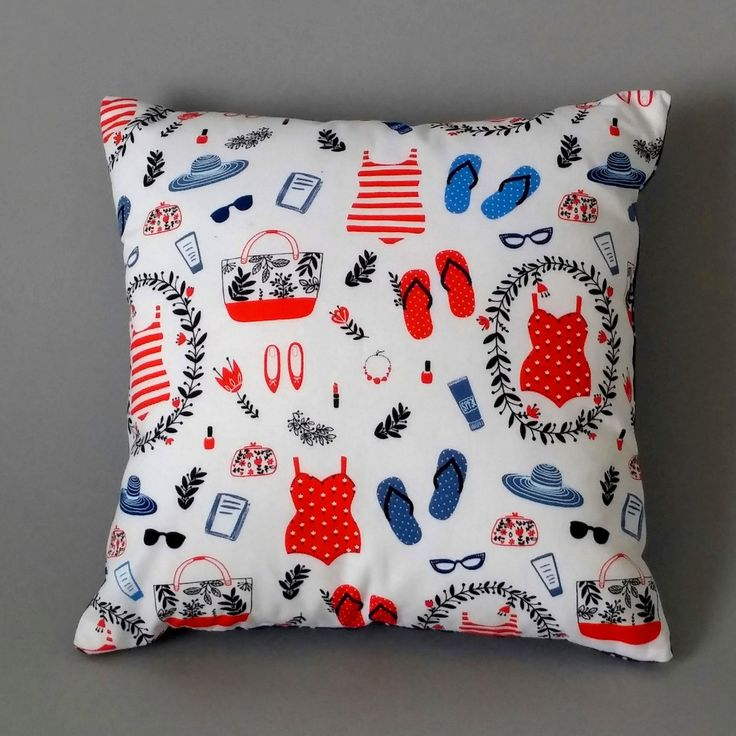 Our 'Beach Beautiful' cushion combines retro 50s inspired 'Swim Accessories' fabric from Windham with white polka dots on a blue background.