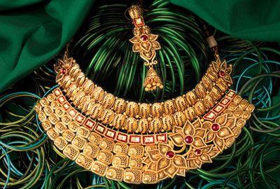 Gold and Diamond jewellery designs: tbz wedding collection
