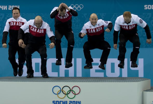 Team Canada, from left, Caleb Flaxey, Ryan Harnden, E.J. Harnden, Ryan Fry and Brad Jacobs jump to the top of the podium in Sochi. (Photos, ...