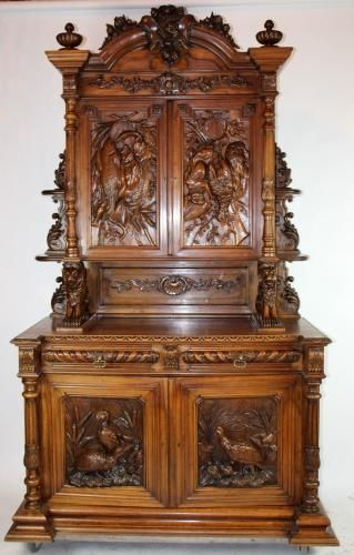 French hunt buffet with relief carved game on doors