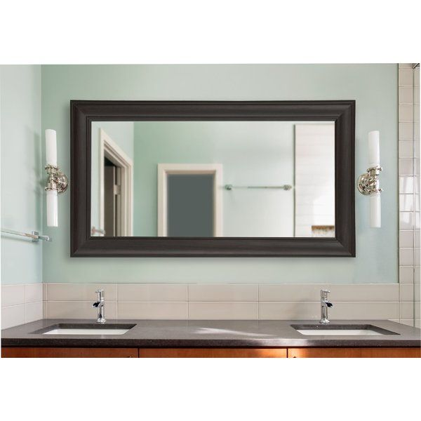 Put the finishing touches on your decor with this beautiful espresso walnut round top framed vanity wall mirror.Elegant and understated, this classic or transitional style mirror is aversatileaccent piece for any home.