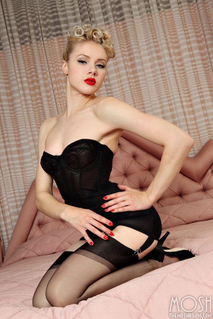 Girls pin corsets stockings up