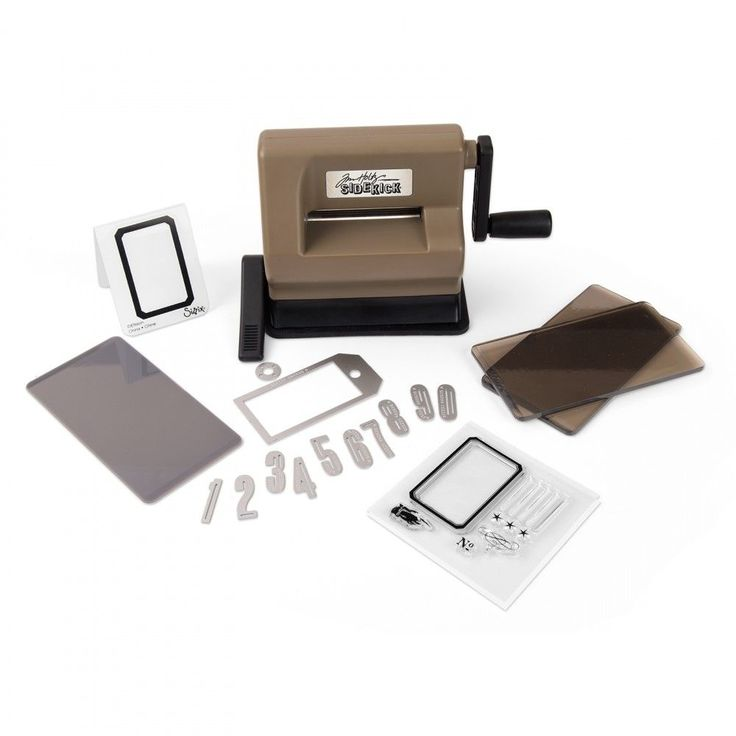 The Tim Holtz Sidekick Die Cutting & Embossing Machine is die-cutting in the palm of your hand! This very cute little machine, in the brown and black colours of the Vagabond/Tim Holtz Alterations, leaves you with no excuses for not using all of those small wafer thin dies. The small size of the cutting pad means you can run a small die, or several small dies, through the Sidekick in seconds rather than dragging out your bigger machines!