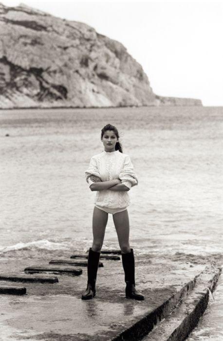 Laetitia Casta. White sweater, #wellies, beach