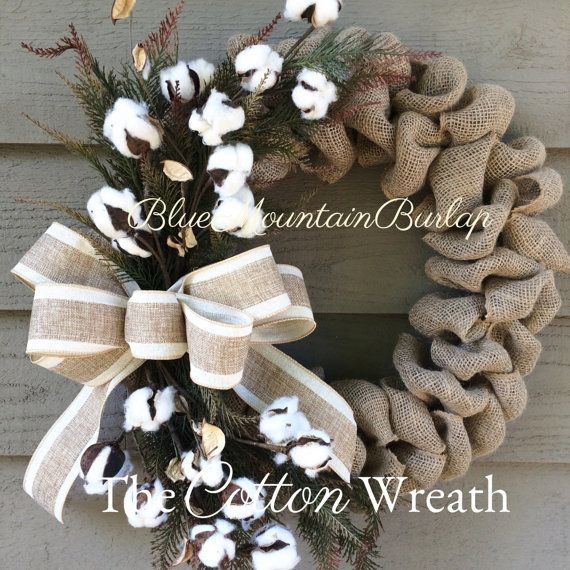 The Cotton Burlap Wreath accented with faux pine greenery, cotton and completed with a beautiful bow! Beautiful Fall/Autumn wreath! The perfect addition to your home...also makes a great gift!  Wreaths measure approx. 20-22