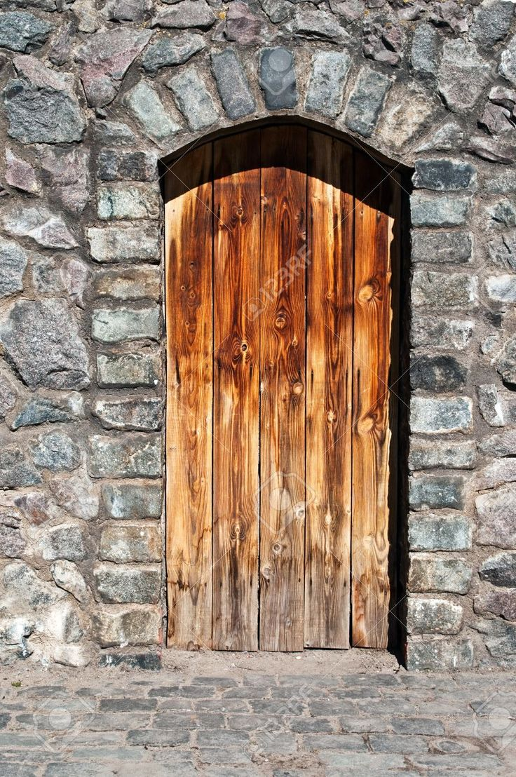 9192010-old-wood-door-in-a-stone-wall-of-an-ancient-building-of-an-abandoned-mountain-village-Stock-Photo.jpg (863×1300)