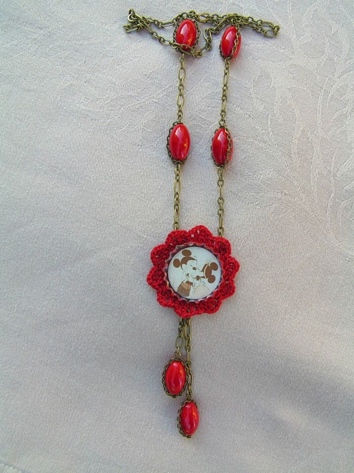 I decorated the vintage style bottle cap pendant with passionate, red lace. The necklace has been complemented some some perfect, red coral beads which harmonize with the color of lace.