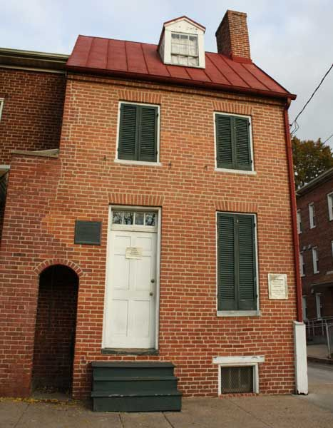 Edgar Allen Poe House  Museum. Baltimore, MD. People have reported being tapped on the shoulder only to turn around and find no one there. Doors open and close by themselves and footsteps can be heard in empty rooms.