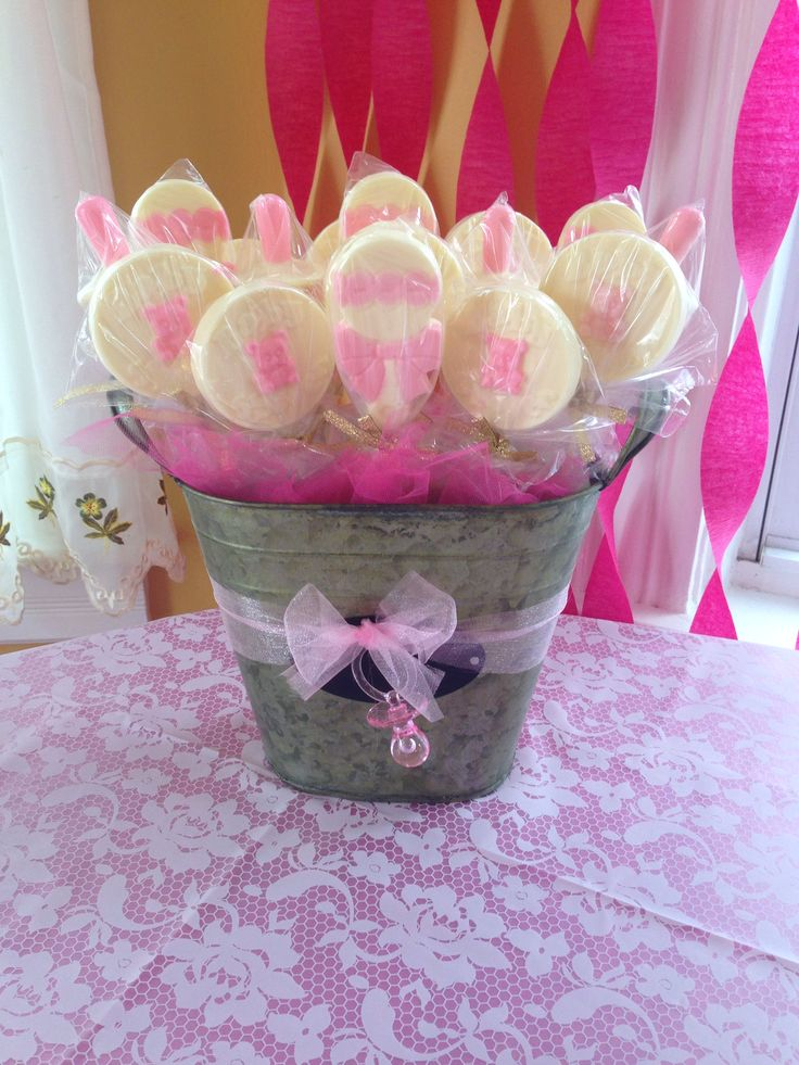 Baby shower favor: white and pink chocolate lollipops in a rustic tin.