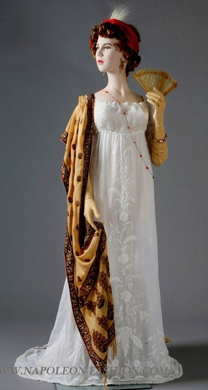 White cotton muslin gown 1802-3, with silk scarf embroidered with gold thread. Napoleon and the empire of fashion