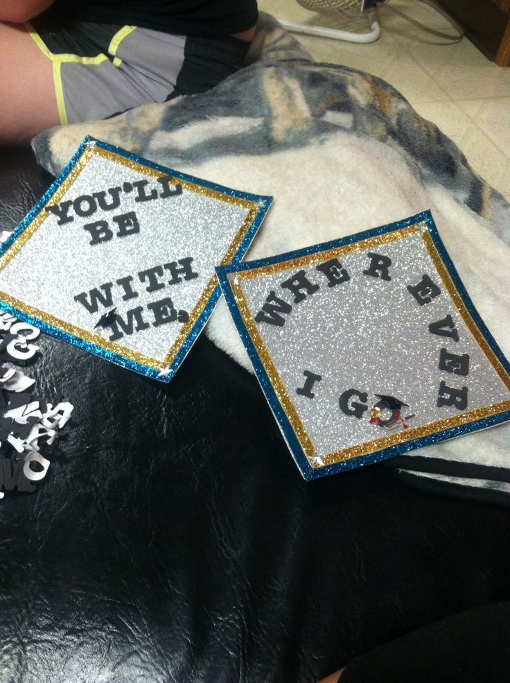 Caitlin and her best friend Avii's graduation cap toppers.