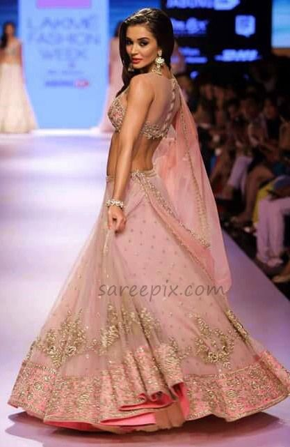 "Amy jackson lehenga ramp walk photos at Lakme Fashion Week (LFW) 2015. The ""Singh is Bling"" actress walked the ramp for designer Anushree reddy in a pink l"