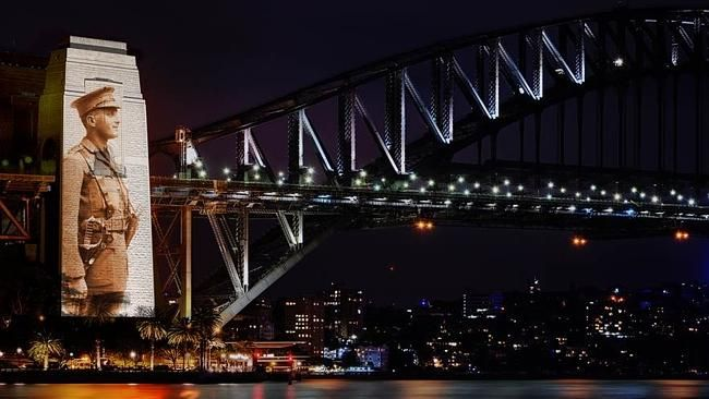 """2015 SYDNEY Harbour Bridge lit up with images of 62,000 falling poppies. Each 1 for a Digger who died in WWI. Poppies will fall from the Bridge pylons every 15 mins as part of a moving tribute lighting up the Sydney landmark with powerful images from WWI - historic portraits of Australian soldiers. """"The Bridge steel pylons standing 89m tall will proudly display images focusing on our brave Anzac men & women who gave their lives for our country,"""" NSW Roads & Maritime minister Duncan Gay said."""
