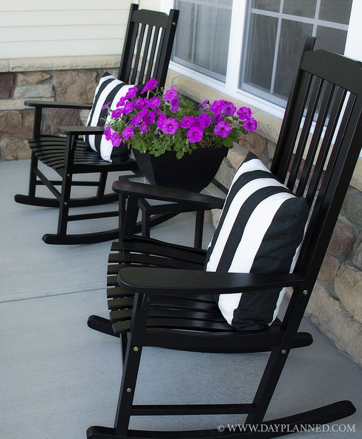 I Love the Black!  I can spraypaint my rocker black--Neat!  Porch with black rocking chairs