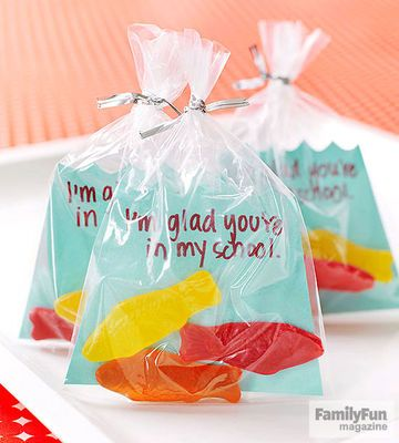 Kids can tell pals how they feel with the help of a school of Swedish Fish. Cut blue card stock into a trapezoid with a wavy top (download our template below). Write a message on the card stock and place it in a 5- by 11 1/2-inch cellophane candy bag with a few Swedish Fish. Seal the bag with a twist tie. Trim the top of the bag with scissors, if needed. Suggested messages: I'm glad you're in my school. It's ofFISHial -- you're awesome! I fish you were mine.