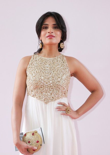 Richa Chada, female lead in Gangs of Wasseypur, carrying Malaga's Invintage clutch at the Cannes Red Carpet