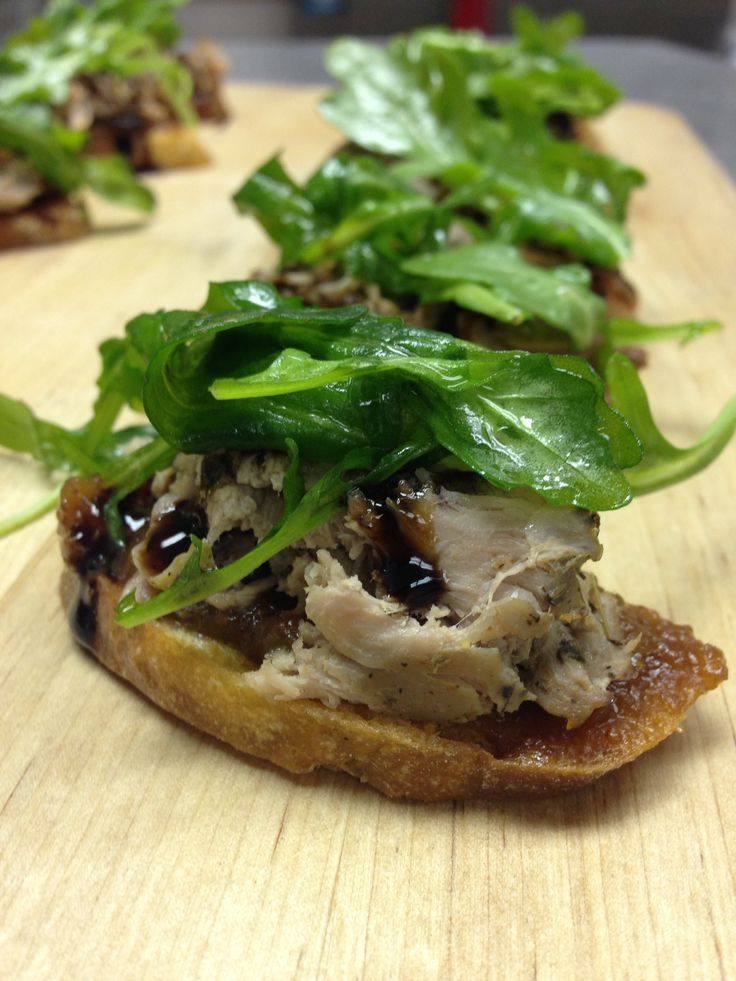 Duck confit with fig jam and arugula.