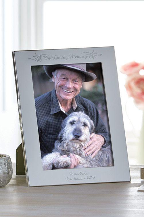 "Plain mirrored silver finish frame, holds 5 x 7"" portrait photograph. H21.9 x W16.5 x D1.1cm."