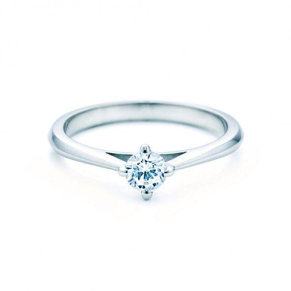 Pierścionek zaręczynowy z diamentem 0,20 ct o szlifie brylantowym wysokiej czystości SI1/G, wykonany z 18-karatowego białego złota (próba 0,750). www.savicki.pl/kolekcje/the-light-pl