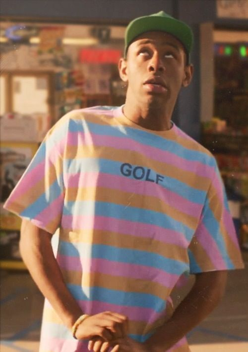 The t-shirt uses the triad magenta, yellow and cyan in paler to tints create a worn-in tee. It will appeal to young men for its simple stylistic approach.