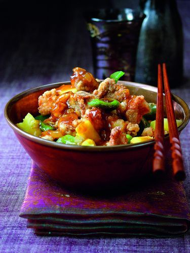 This homemade Sweet and Sour Pork, from Yan Kit's Classic Chinese Cookbook will beat any takeaway version could order. The pork is cooked so it's crispy on the outside and tender on the inside, and is then topped with a well-balanced sweet and sour sauce. Mouth-wateringly good.
