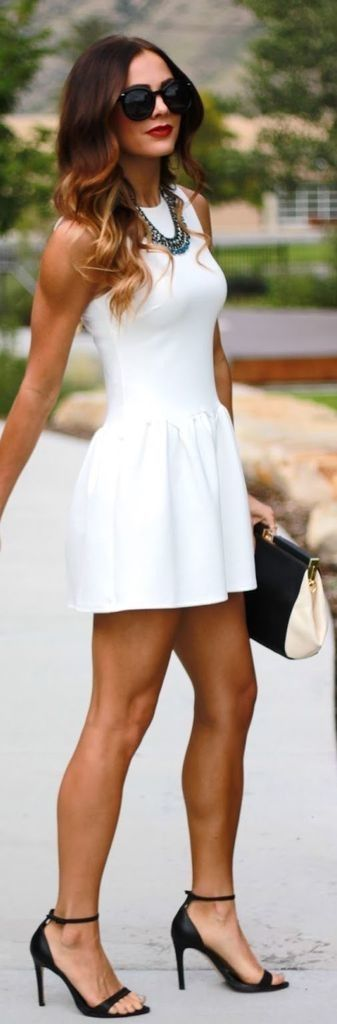 Perfection of white Summer dress clean lines well fitted